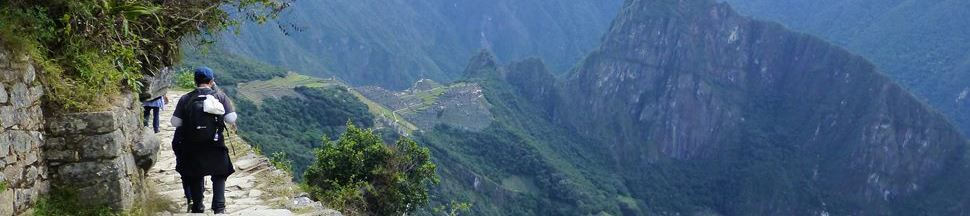Inca trail tour arriving to Machu Picchu
