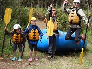 Happy family rafting