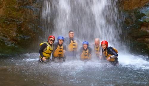 Family happy under waterfall